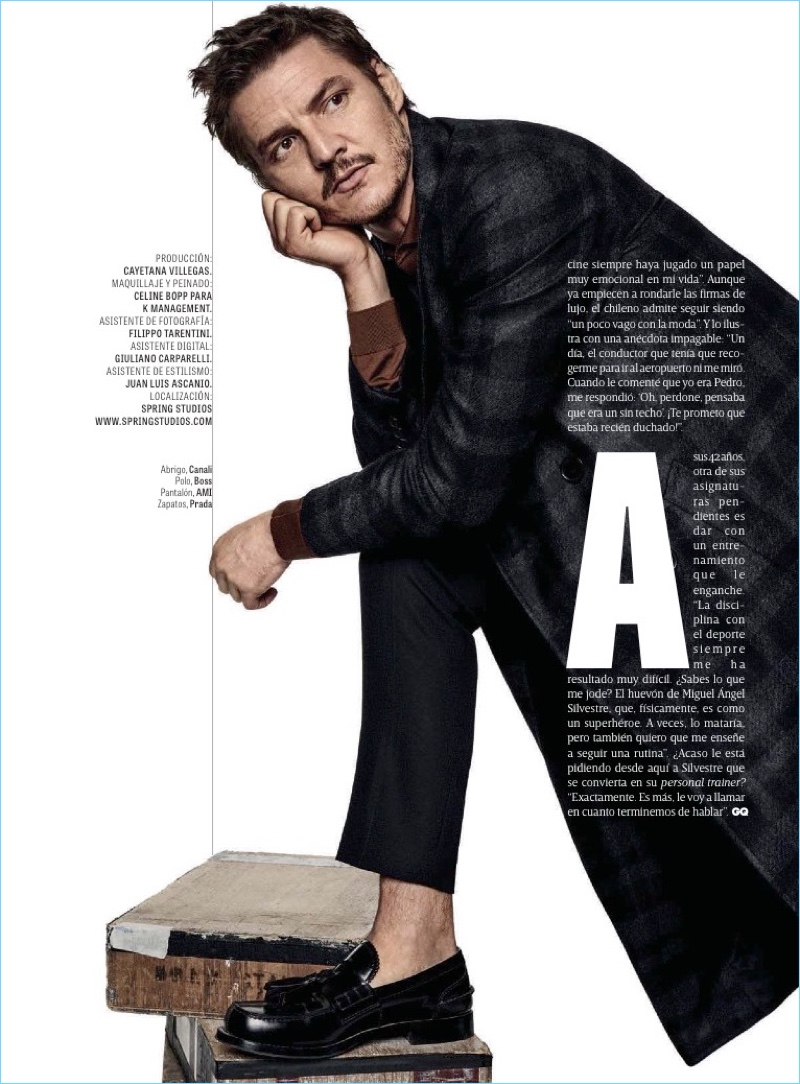 Charming to say the least, Pedro Pascal dons a Canali coat. Pascal also wears a BOSS polo, AMI pants, and Prada shoes.