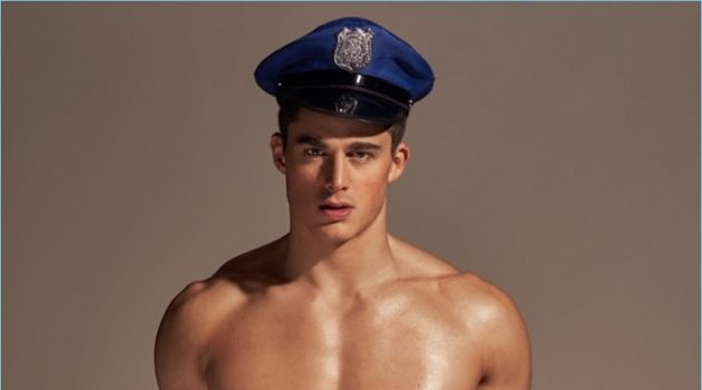 Pietro Boselli dresses up as a cop for a BENCH/ Body underwear promo image.