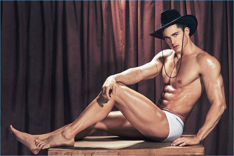 Model Pietro Boselli wears a western-style hat for a BENCH/ Body underwear photo shoot.
