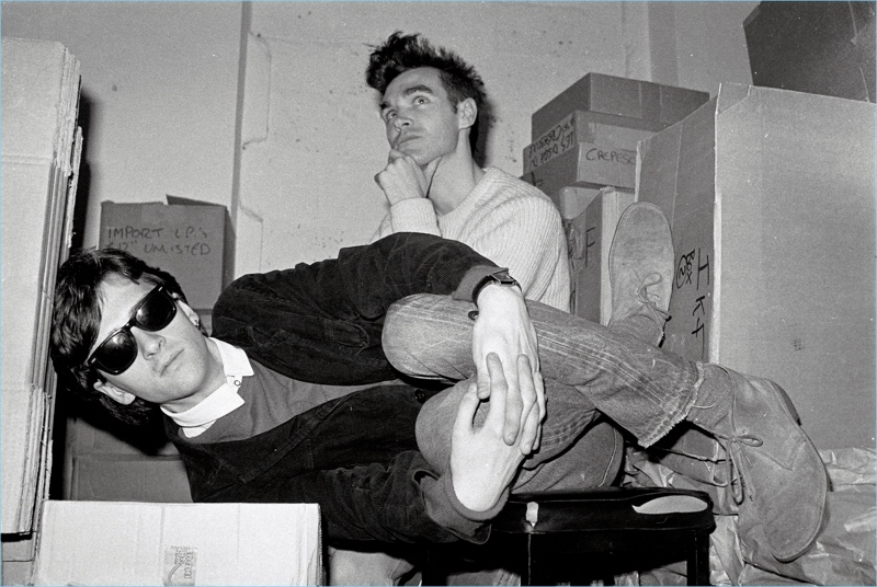 Johnny Marr and Morrissey  of The Smiths pose for a picture. Marr wears Ray-Ban Wayfarer sunglasses.