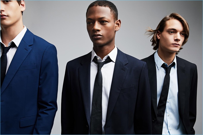 Models Jegor Venned, Lucas Cristino, and Timur Muharemovic come together in Theory suits.
