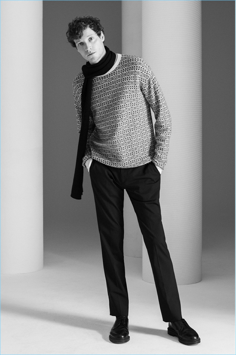 Dressed for winter, Matthew Hitt wears a Theory cashmere fair isle sweater and scarf. Theory's stretch wool Jake pants complete the look.