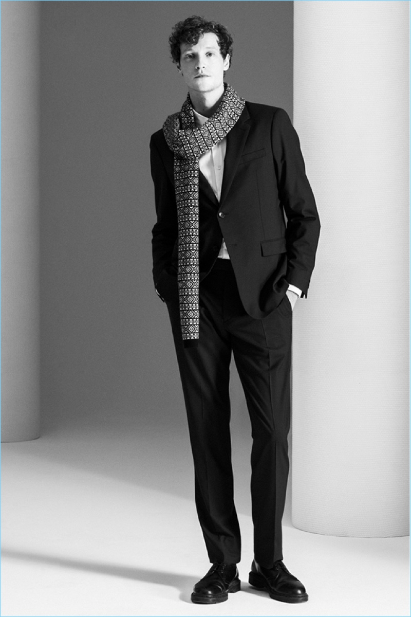 Theory's Good Wool suit jacket and pants shines with a slim shirt. A cashmere fair isle scarf adds a holiday splash.