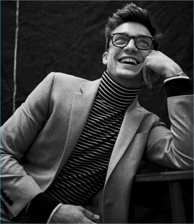 All smiles, Alexis Petit wears Todd Snyder's Italian heather wool flannel sport coat with a striped turtleneck.