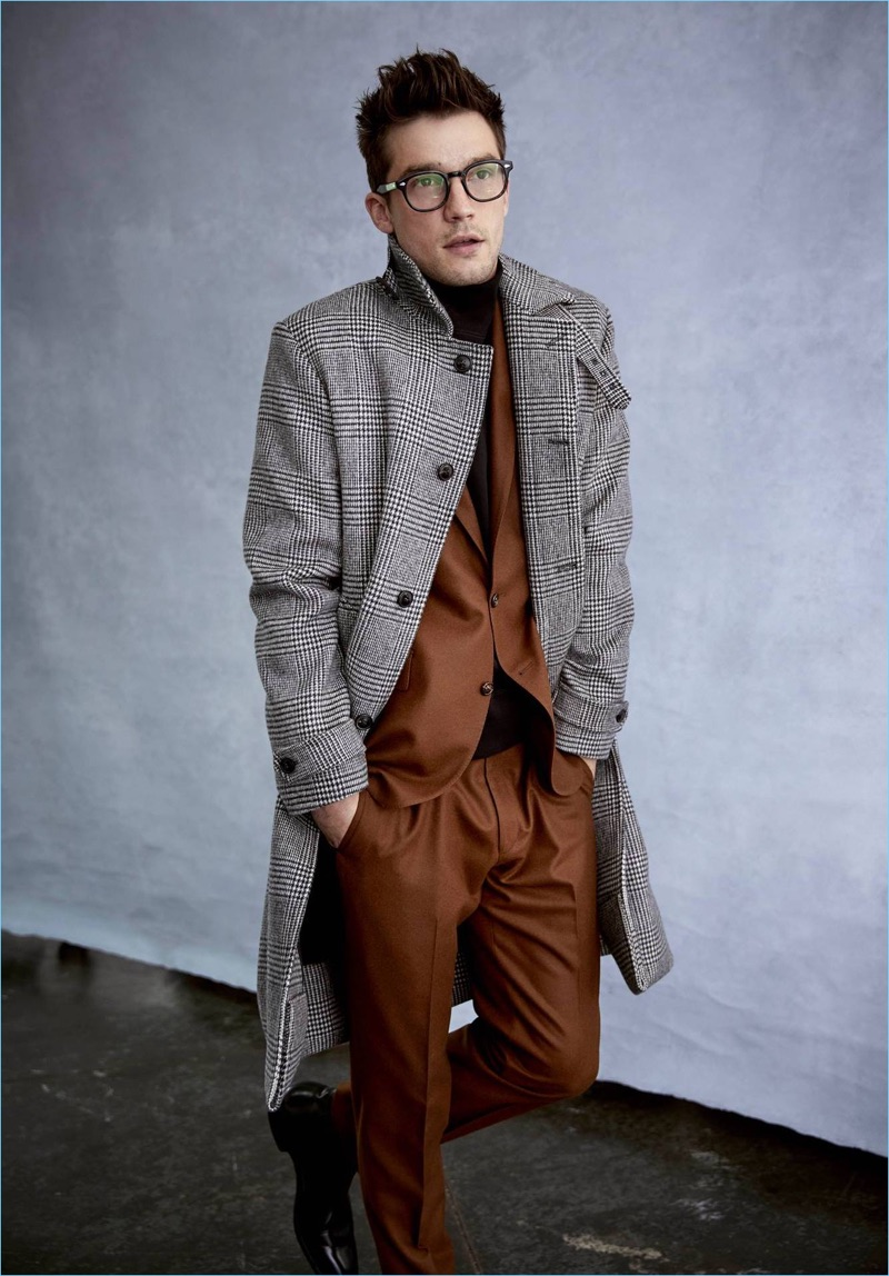 Todd Snyder not only features a rich Italian acorn brown flannel suit but a glen plaid topcoat.