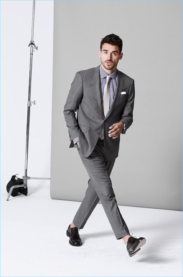Model Arthur Kulkov wears Todd Snyder's stretch Italian wool Sutton suit in light grey.