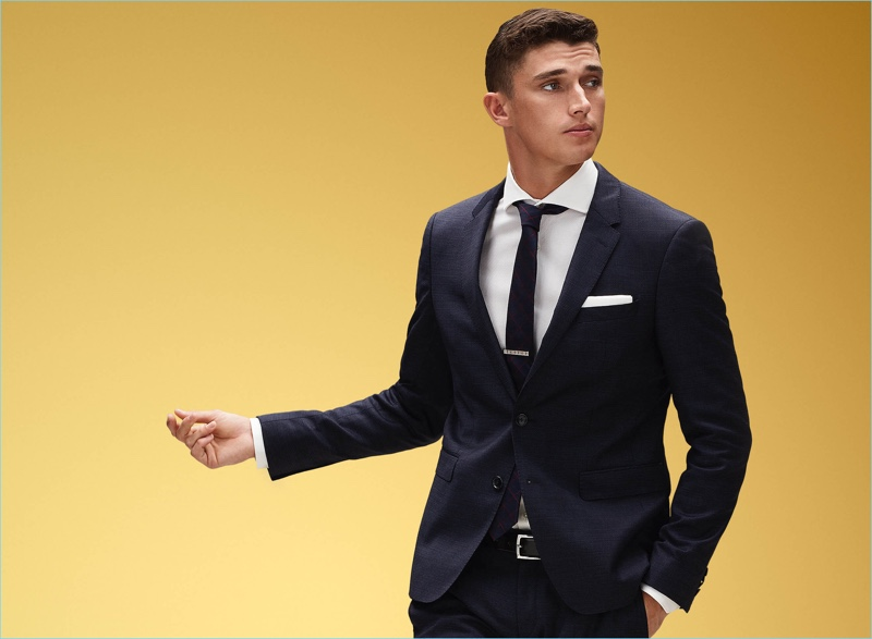 Matthew Holt dons a sharp suit from Tommy Hilfiger's holiday 2017 range.