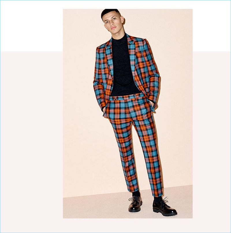 Take a style tip from Topman and wear a bold plaid suit for the holidays.