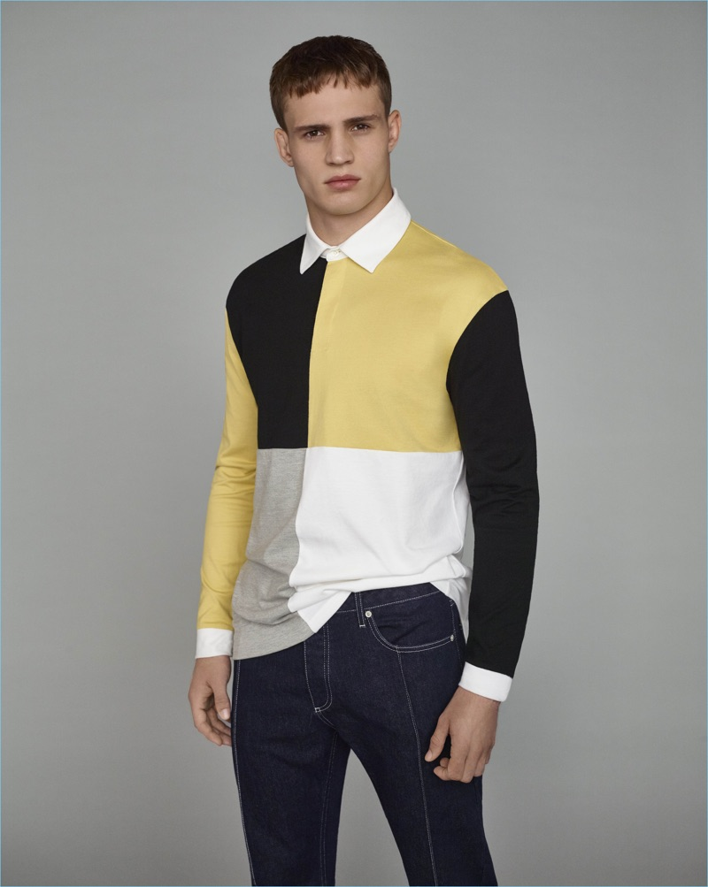 Julian Schneyder sports a color blocked polo for Topman's fall-winter 2017 campaign.