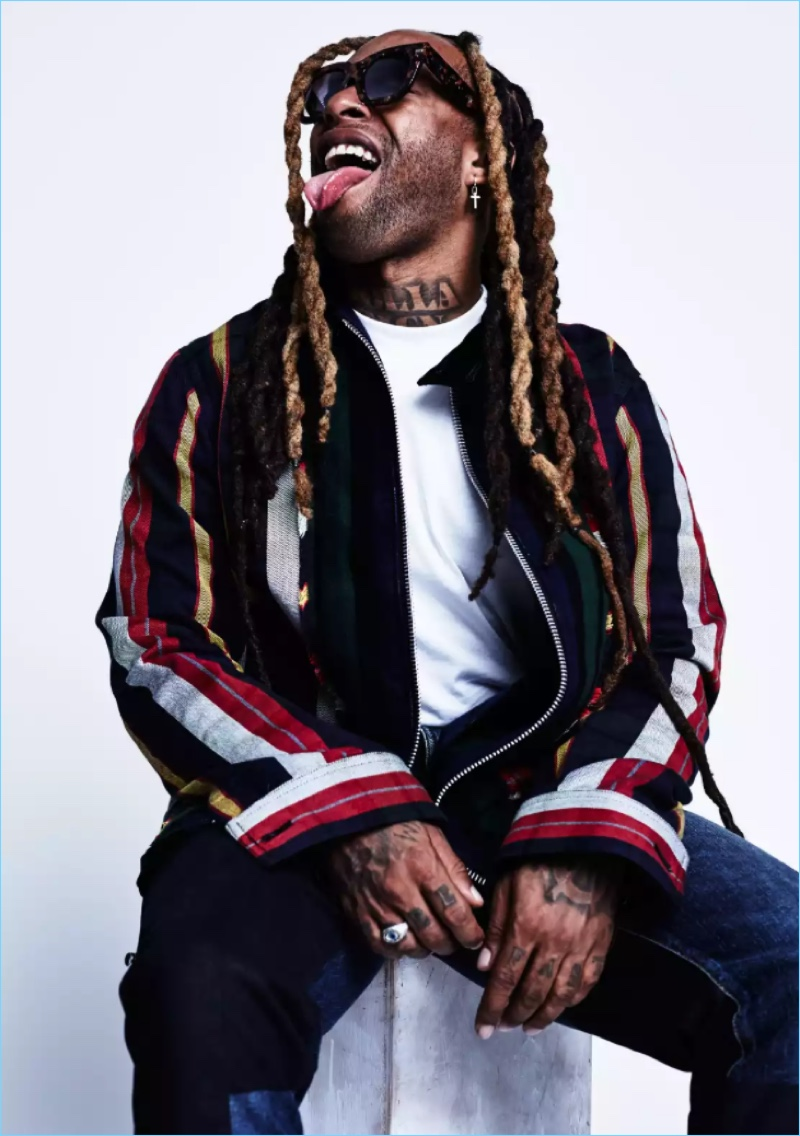 Ty Dolla $ign wears a striped Sacai jacket with Nudie Jeans jeans.