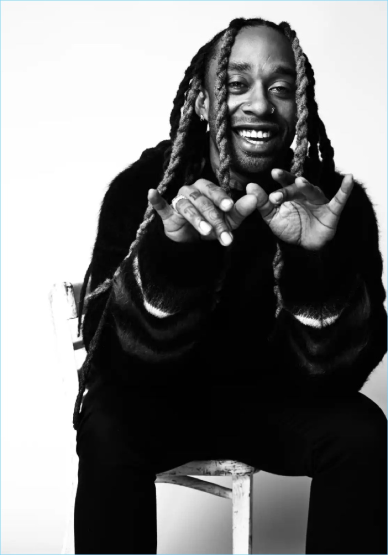 All smiles, Ty Dolla $ign wears a Loewe sweater.