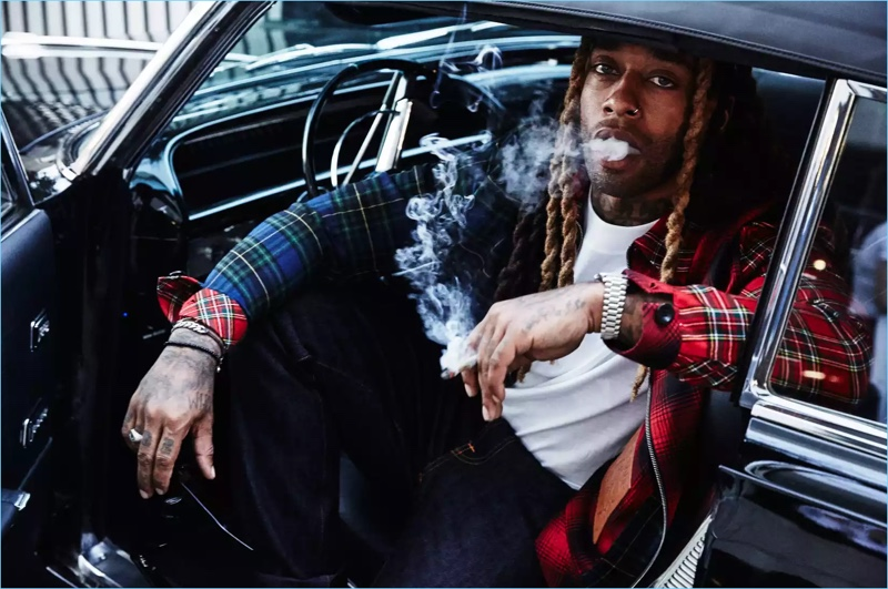 Getting behind the wheel, Ty Dolla $ign wears a Loewe jacket and NUDIE JEANS jeans.