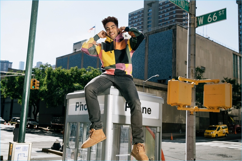 Wearing UGG Neumel Twinface Chukka boots, KYLE stops by the last phone booth in New York City.