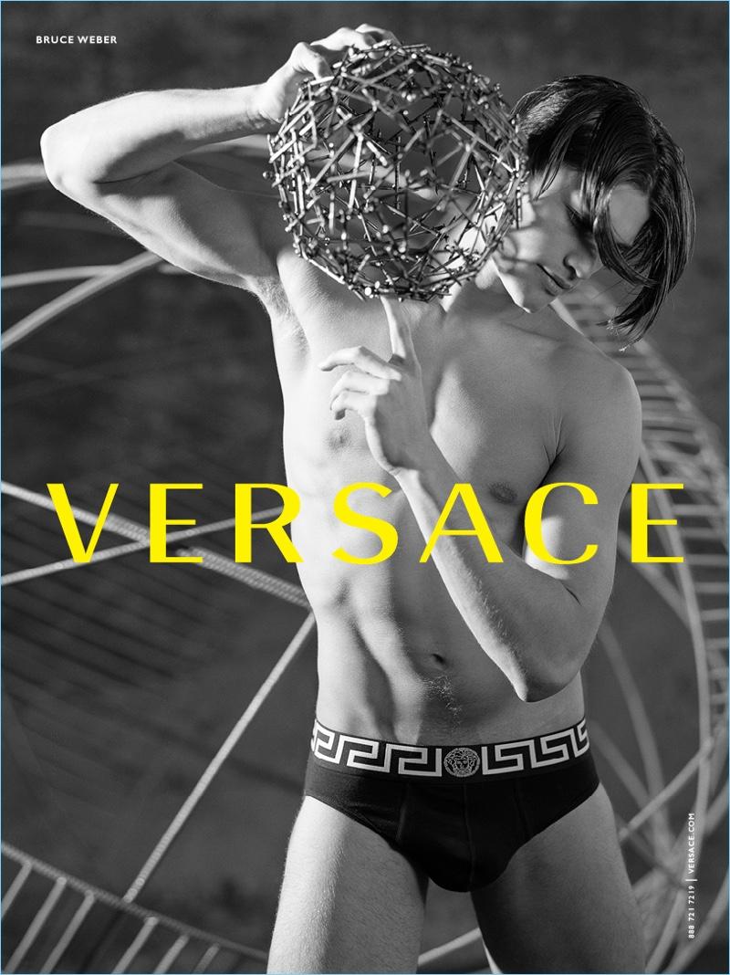 Model Michael Gioia sports underwear for Versace's fall-winter 2017 campaign.