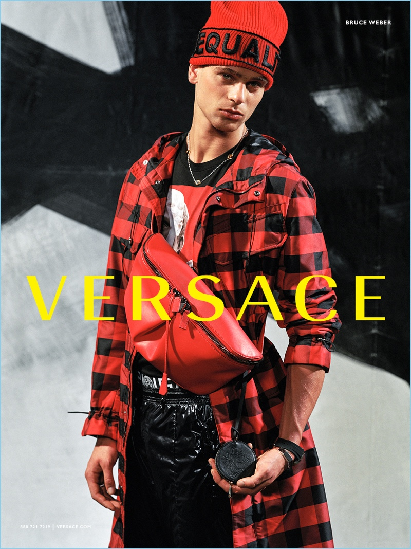Barry Lomeka rocks a red and black look for Versace's fall-winter 2017 campaign.