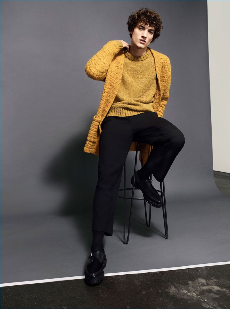 Embracing a pop of color, Serge Rigvava layers mustard yellow knitwear by Zara Man.