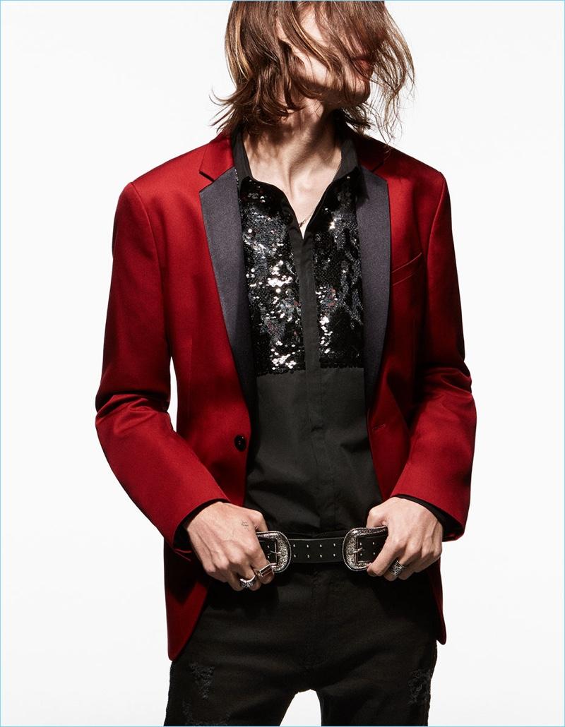 Marcel Castenmiller wears a red tuxedo jacket, embellished shirt, and skinny jeans by Zara Man.