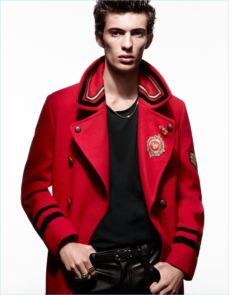 Front and center, Piero Mendez shines in a red officer coat by Zara Man.