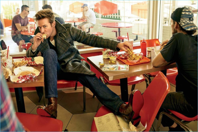 Grabbing a bite to eat, Armie Hammer wears a Bottega Veneta coat. The American actor also rocks a sweater, t-shirt, and jeans by Dior Homme with Christian Louboutin boots.