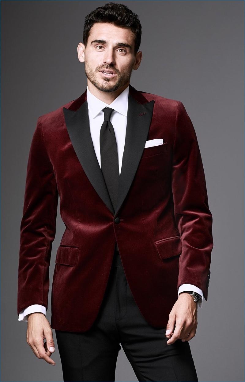 A Festive Affair: Dressed to impress, Arthur Kulkov dons a Todd Snyder tuxedo jacket in burgundy Italian velvet.