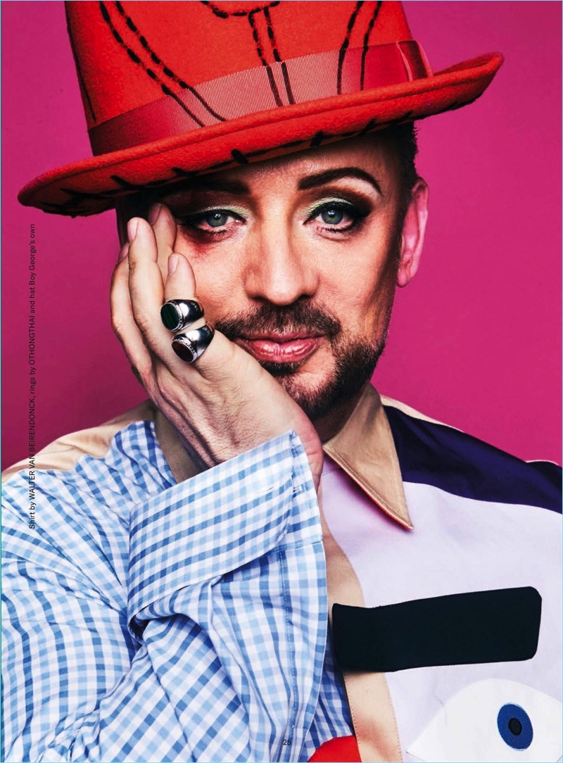 Singer Boy George wears a Walter van Beirendonck shirt with one of his custom hats.
