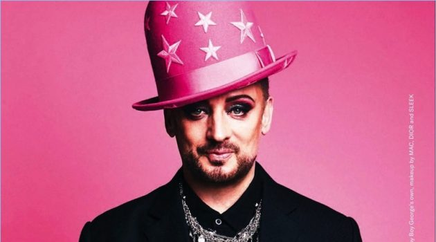 Sporting another one of his own hats, Boy George rocks a Maison Margiela shirt with a Pebble London necklace and his own pieces.