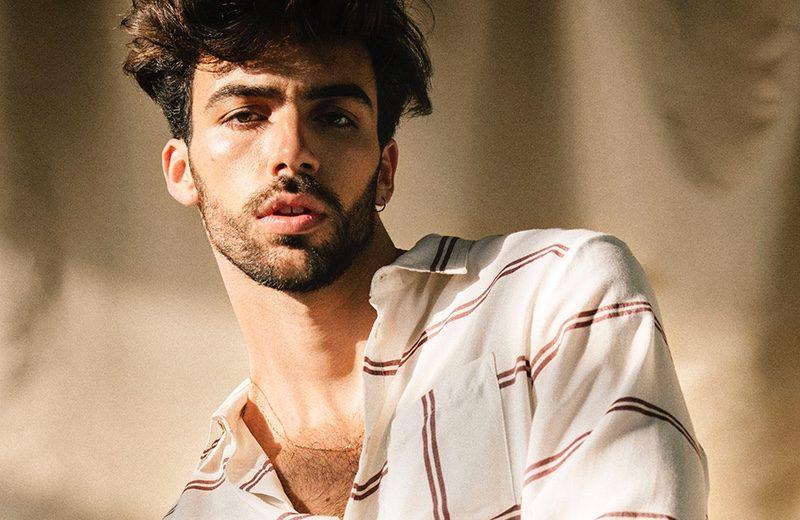 Carlos wears shirt Colmillo de Morsa and pants Sandro.