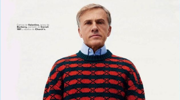 Actor Christoph Waltz wears a Valentino sweater, Burberry shirt, and Cerruti 1881 pants.