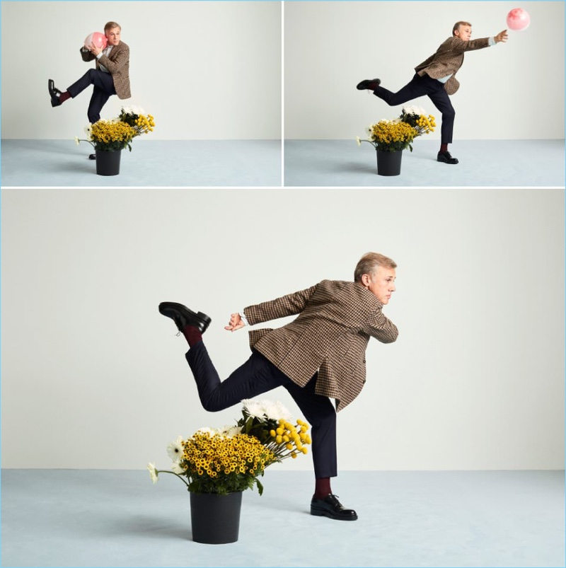 Actor Christoph Waltz wears an Incotex blazer, Sandro trousers, and AMI shoes.