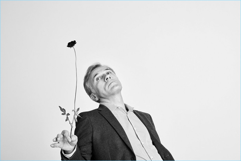 Appearing in a black and white photo, Christoph Waltz wears a Prada blazer and Joseph shirt.