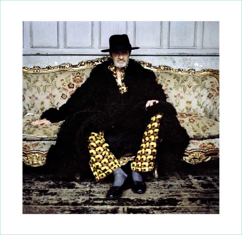 Embracing an over the top look, Rupert Everett wears Prada pajamas with an Alexander McQueen coat.