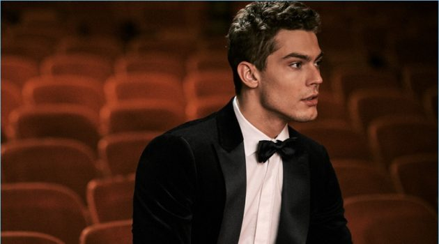 The New Year's Eve Event: Model Jacob Hankin wears a Theory tuxedo and shirt with a Salvatore Ferragamo leather belt.