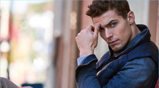 Model Jacob Hankin wears a Sunspel sweatshirt, AG jacket, and an Arc'Teryx Cerium vest. The Australian model also sports 7 For All Mankind jeans.