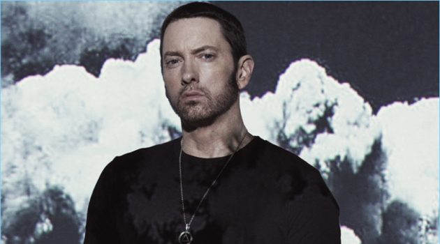Rapper Eminem wears a Goodlife t-shirt with AllSaints pants.