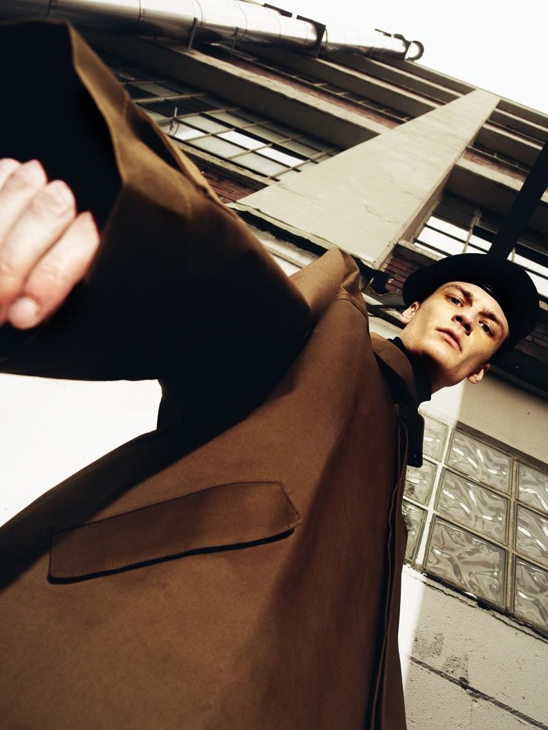 Marcel wears beret Alexander McQueen and coat Hed Mayner.