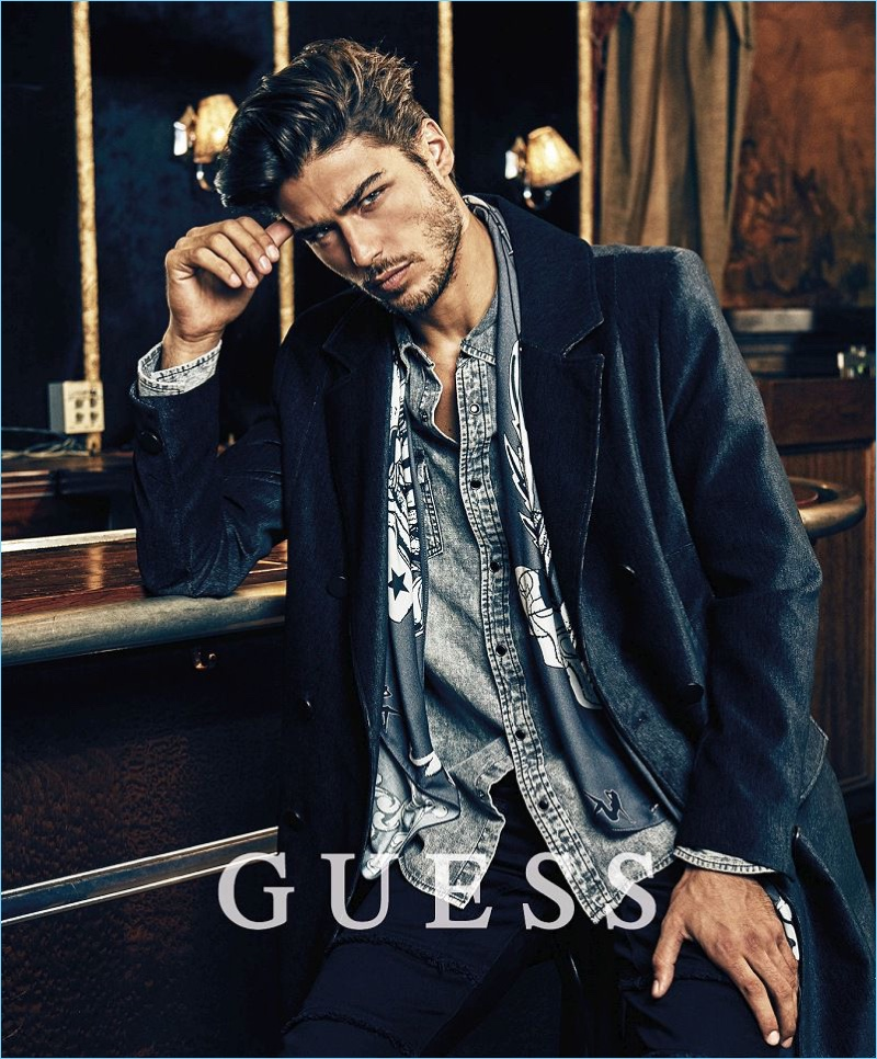 Model Alessandro Dellisola appears in Guess' holiday 2017 campaign.