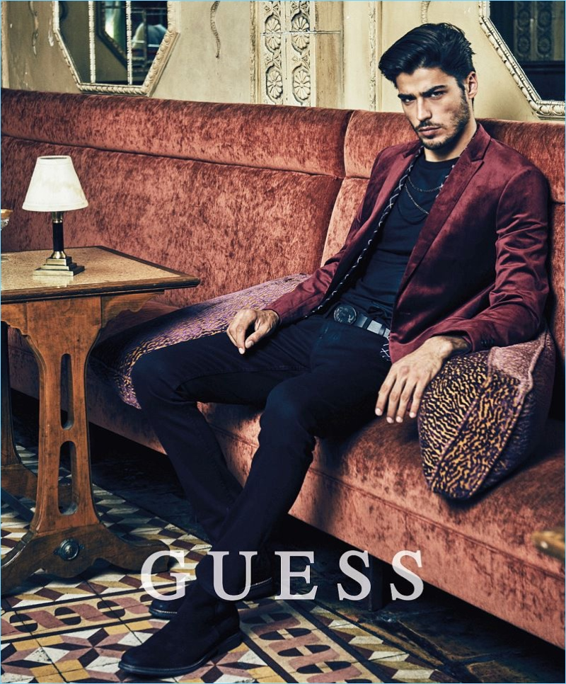 Sporting a velvet blazer, Alessandro Dellisola fronts Guess' holiday 2017 campaign.
