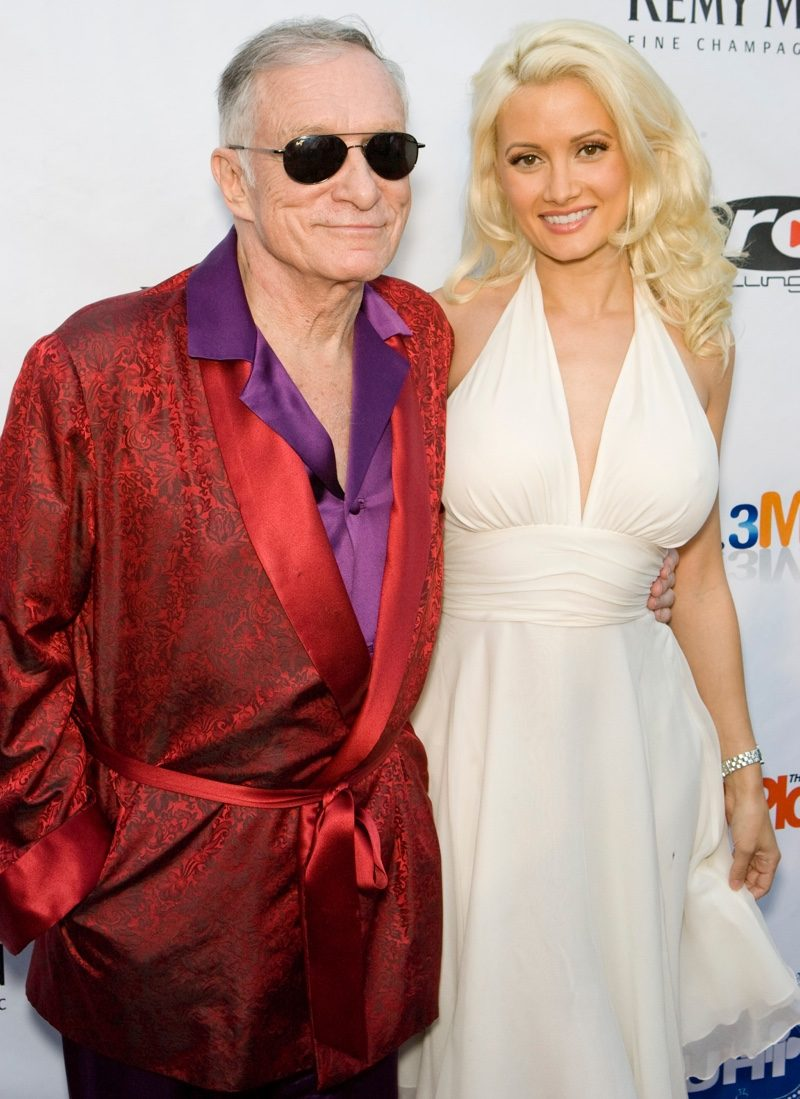 Hugh Hefner and Holly Madison attend the 3rd Annual Urban Health Institute Poker Tournament and Casino Night. Here, he's pictured in his iconic red smoking jacket.