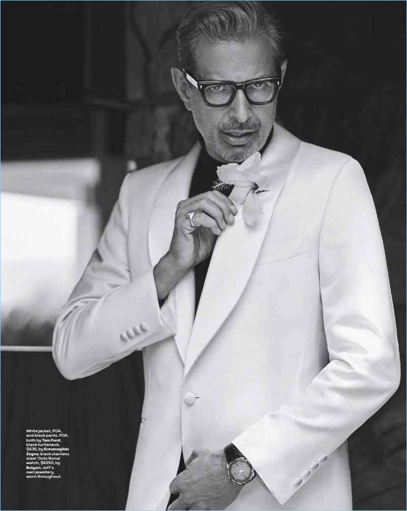 Dressed to impress, Jeff Goldblum wears a white jacket and pants by Tom Ford. Goldblum also rocks an Ermenegildo Zegna turtleneck.