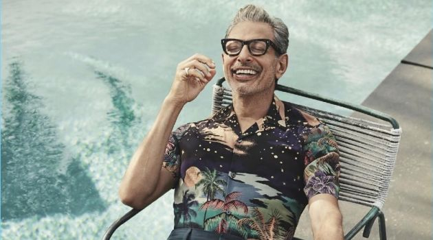 Relaxing poolside, Jeff Goldblum wears a Paul Smith shirt with Prada pants, a Josephs Shoes footwear.