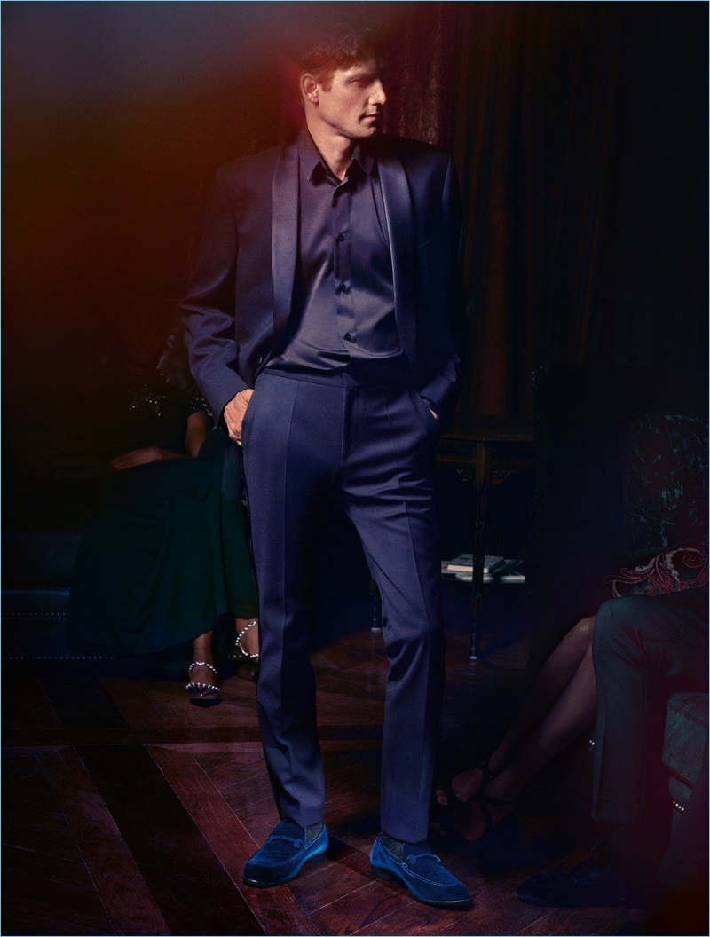 """Roch Barbot dons Jimmy Choo """"Marti"""" navy velvet loafers from the brand's cruise 2018 collection."""
