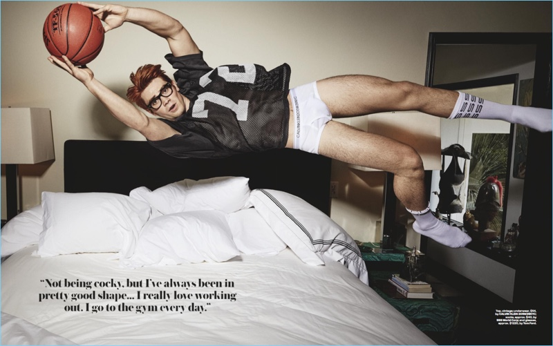 Riverdale actor KJ Apa rocks a vintage jersey with Calvin Klein underwear and Tom Ford glasses.