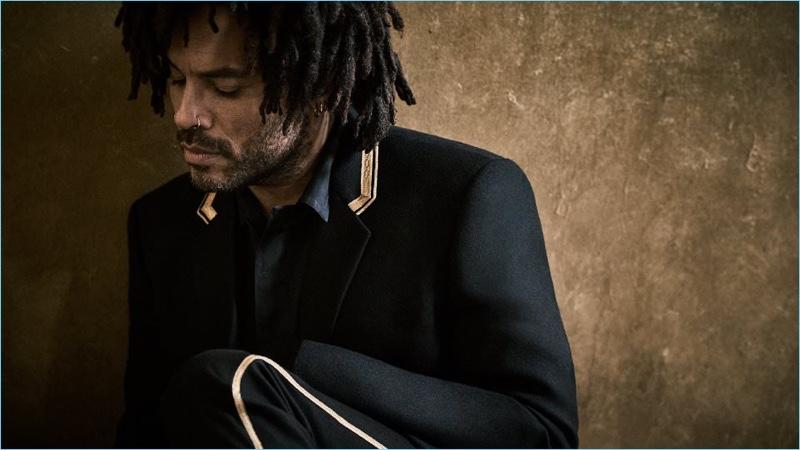 Stealing a quiet moment, Lenny Kravitz wears a Saint Laurent blazer with a Haider Ackermann overshirt.