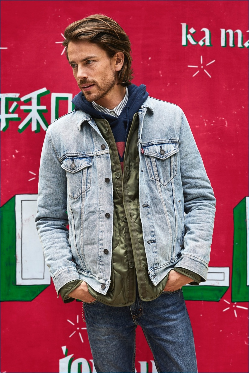 Jeremy Young rocks Levi's iconic denim trucker jacket.