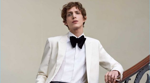 Dressed for a formal event, Xavier Buestel wears a Saint Laurent tuxedo jacket with a Valentino shirt. He also dons Lemaire trousers and a Prada leather belt.