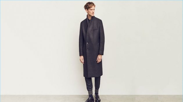Front and center, Bastiaan Ninaber wears a double-breasted coat and track pants by Wooyoungmi. The top model also sports a Lemaire shirt and Lanvin derby shoes.