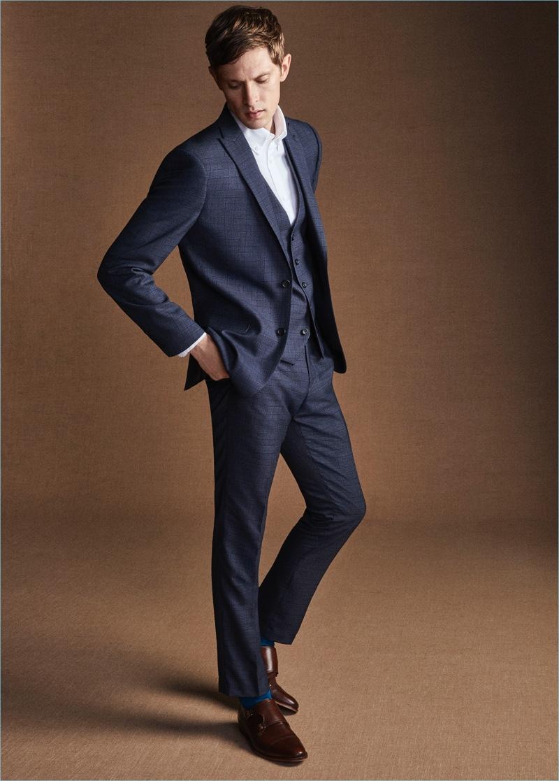 Mathias Lauridsen dons a sharp navy suit for Next.