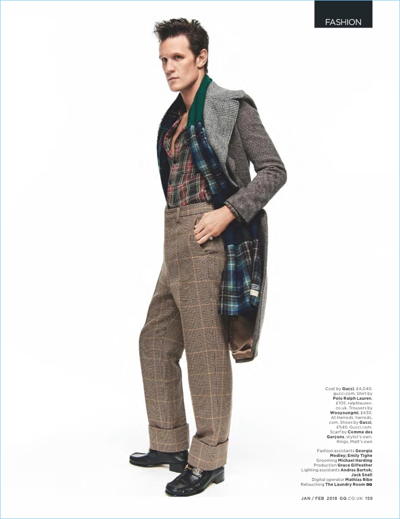 British GQ enlists Matt Smith for a fashion shoot. He wears a Gucci coat with a POLO Ralph Lauren shirt and Wooyoungmi trousers. Smith also sports a Comme des Garçons scarf and Gucci shoes.