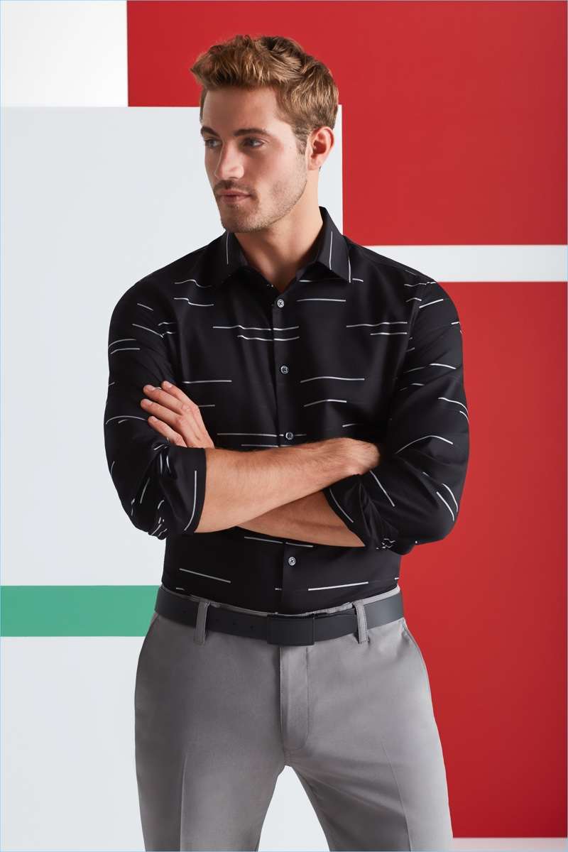 Office Holiday Party: Making a graphic statement, Will Higginson models a Perry Ellis horizontal stripe shirt with pants and a coated leather belt.