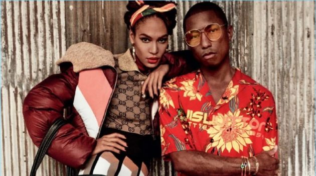 Embracing tropical style, Pharrell appears in a photo shoot with Joan Smalls. He wears a Louis Vuitton shirt with Cactus Plant Flea Market shorts, and Gentle Monster sunglasses. The artist also sports Adidas Originals sneakers and a Balenciaga bag.